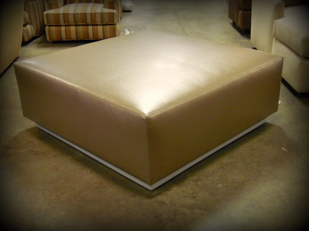 Square ottoman with recessed metal base