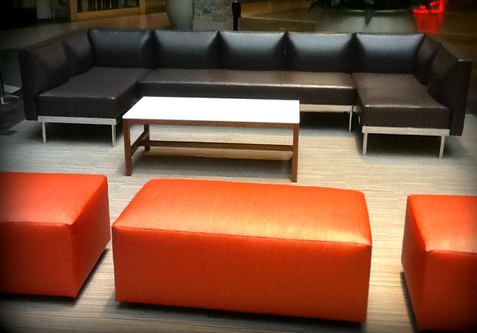 This basic rectangular ottoman with recessed feet gets a boost of color from its commercial-grade vinyl textile.
